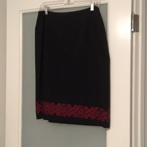Black skirt with red embroidered design at bottom